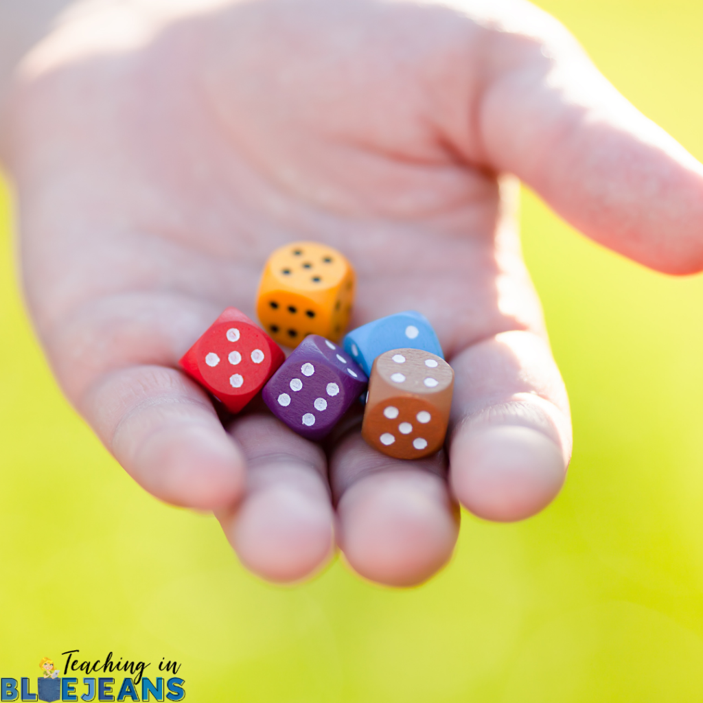 student rolling dice is a great hands-on way to practice basic math facts