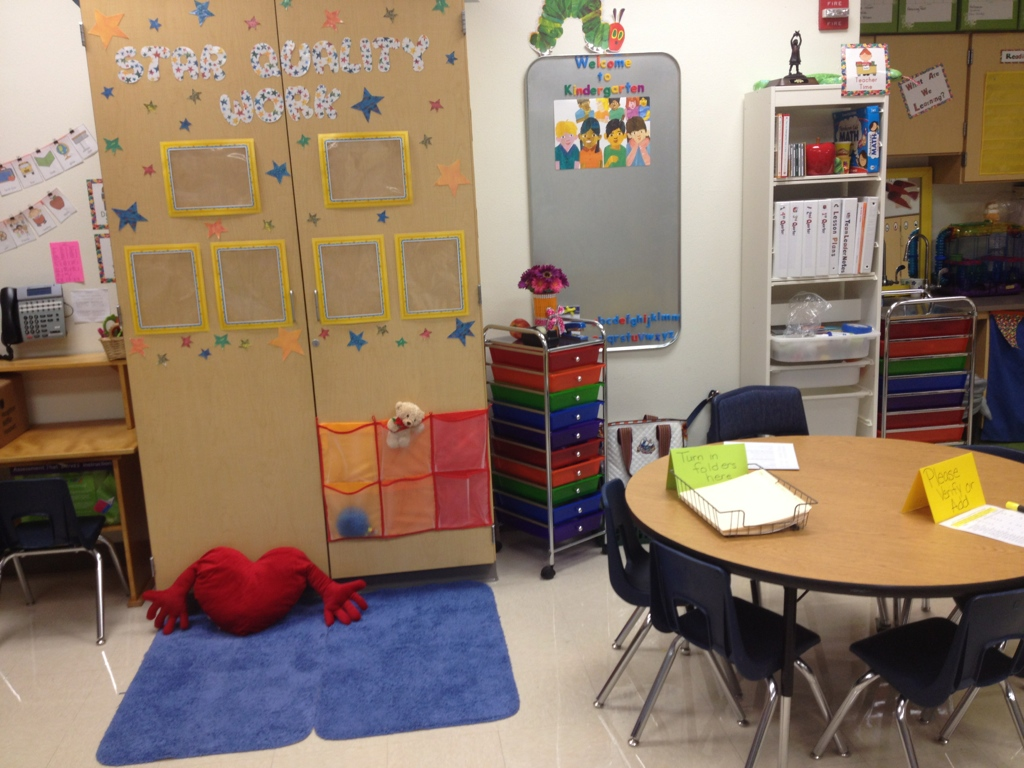 Organize the classroom and maximize the space by using the small group instruction table doubled as my teacher work space